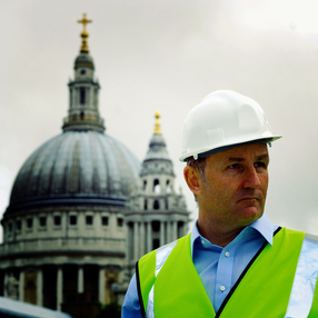 St Pauls with man in PPE in front
