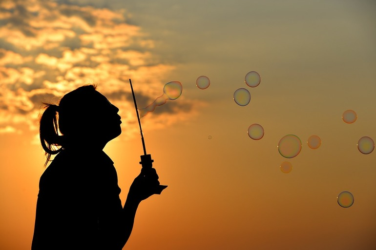 Girl blowing bubbles - Happy in Life - Work Abroad