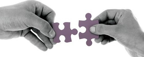 puzzle pieces linking to reflect Next Phase Recruitment connecting candidates and clients