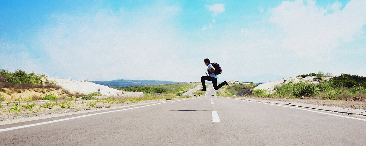 Man jumping across a road