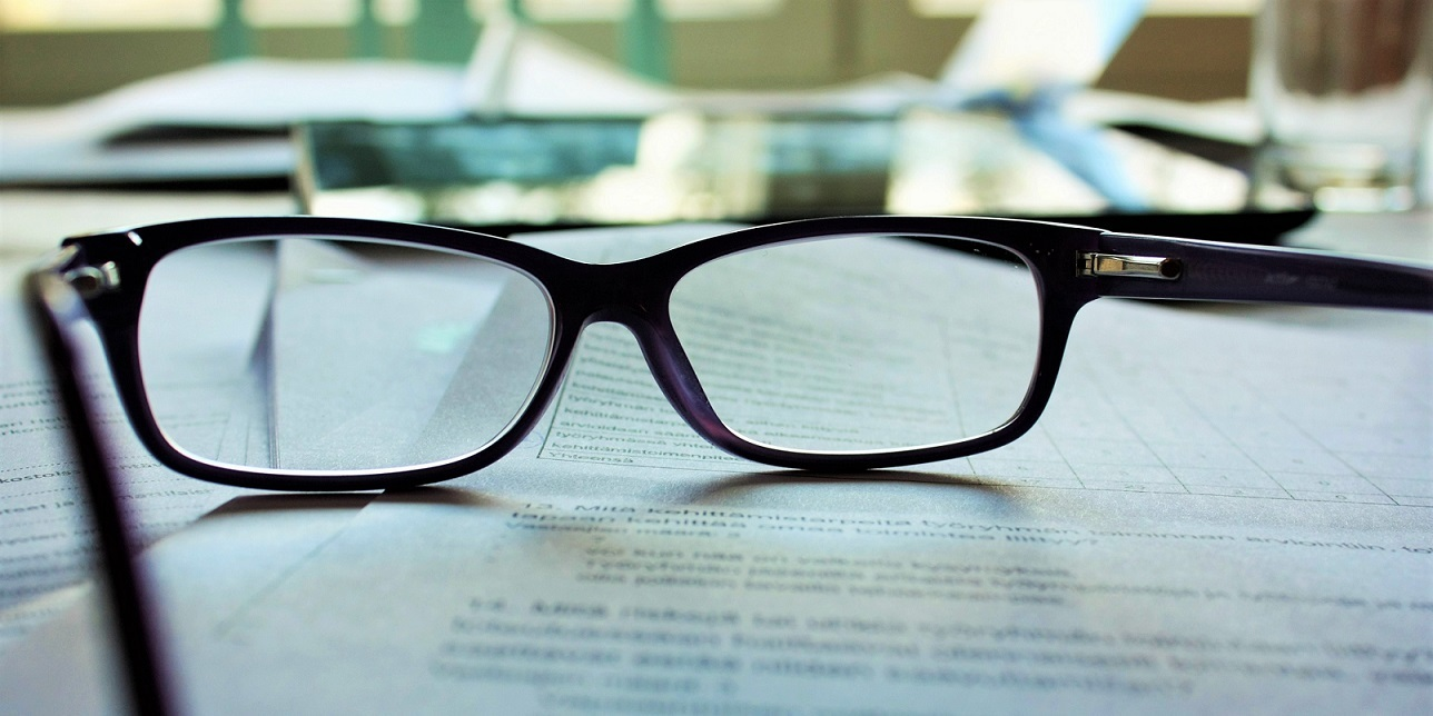 Glasses resting on paperwork