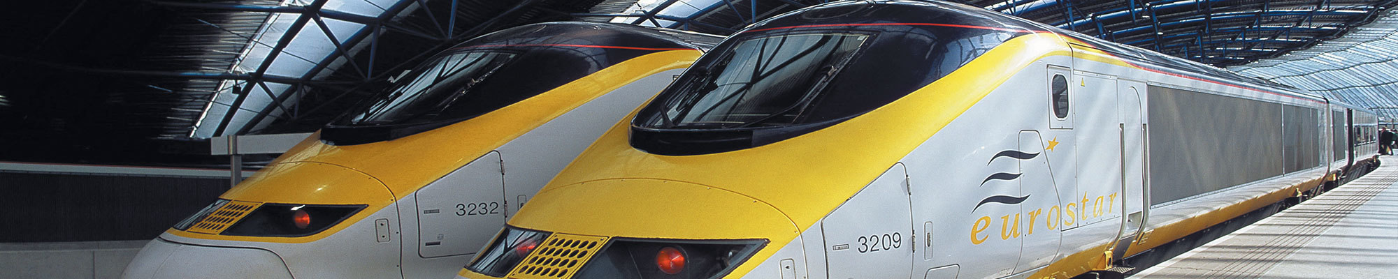 two yellow and white eurostar trains
