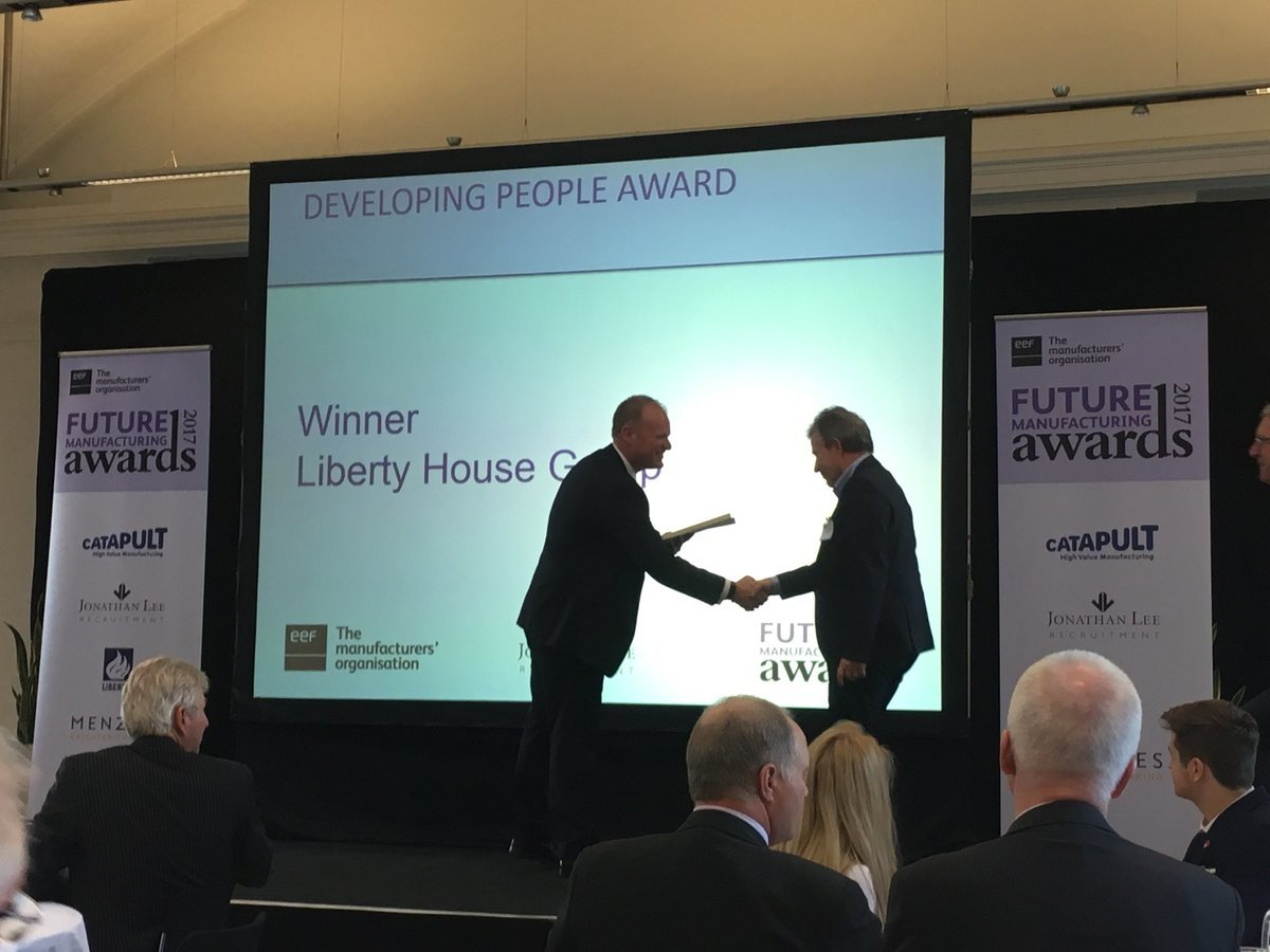 Jason Cole, Client Relationship Manager of Jonathan Lee Recruitment presents regional Developing people award to Liberty House Group
