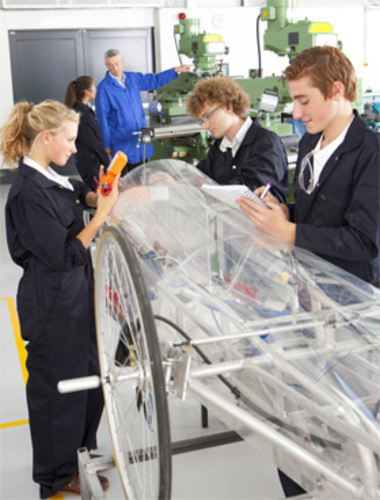 Young engineers and apprentices at work