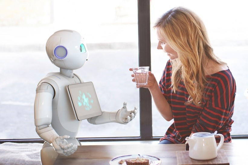 Lady taking to a robot