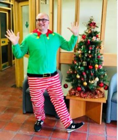Gareth Simpson, automotive recruitment consultant dressed as an elf for Christmas Jumper Day