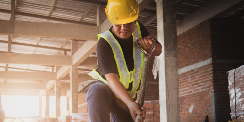 Labourer working in construction job on housing site building his career