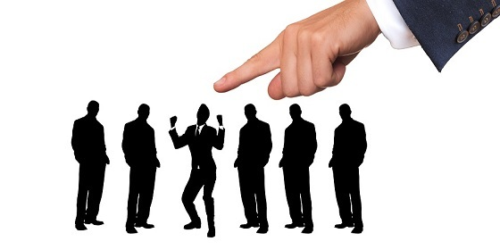 Image of group of job seekers with one being selected by large image of hand above them