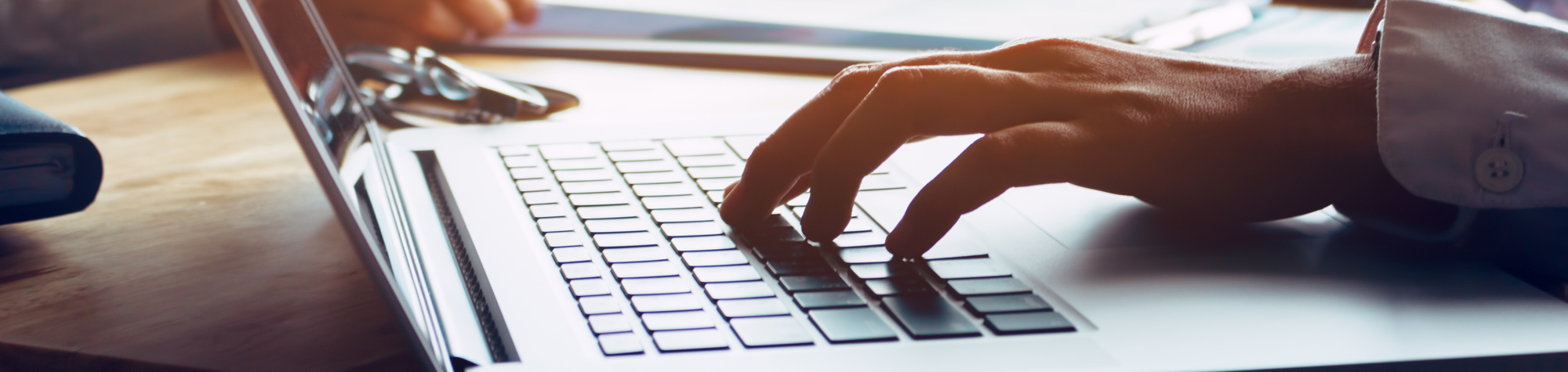 Search Contact Form Header Image. Featuring the hands of a male candidate typing his contact details on his laptop keyboard so that Search Consultancy can respond to his query about jobs and careers. Search Consultancy.