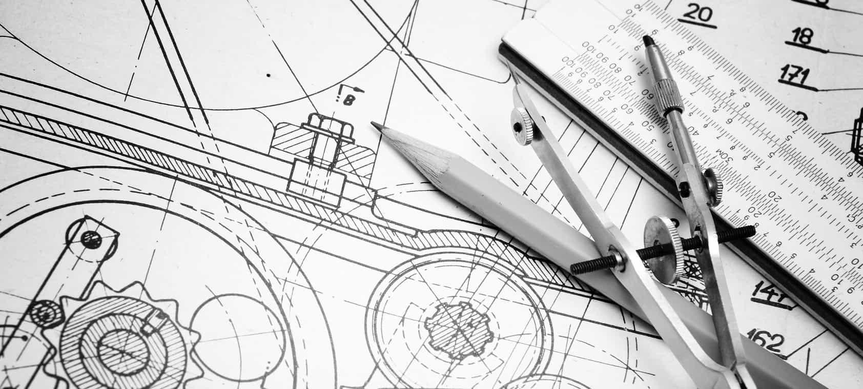 A black and white photo of an engineering drawing, pencil, compass and ruler