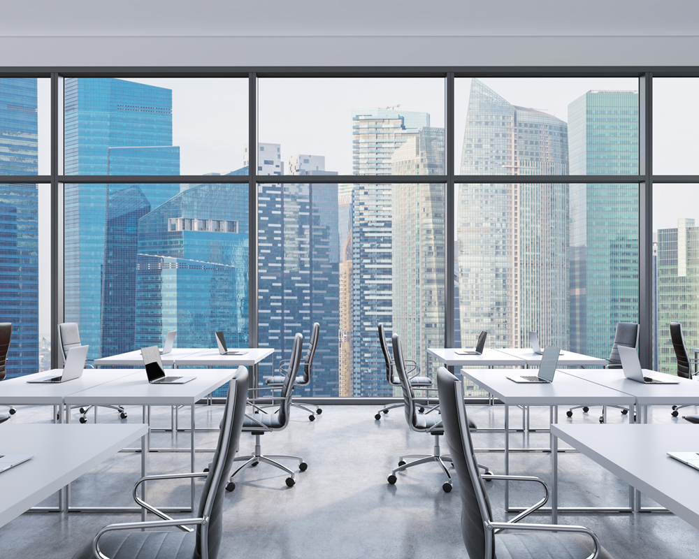 Modern office in modern building. White desks in an open planned top floor office from Search Consultancy.