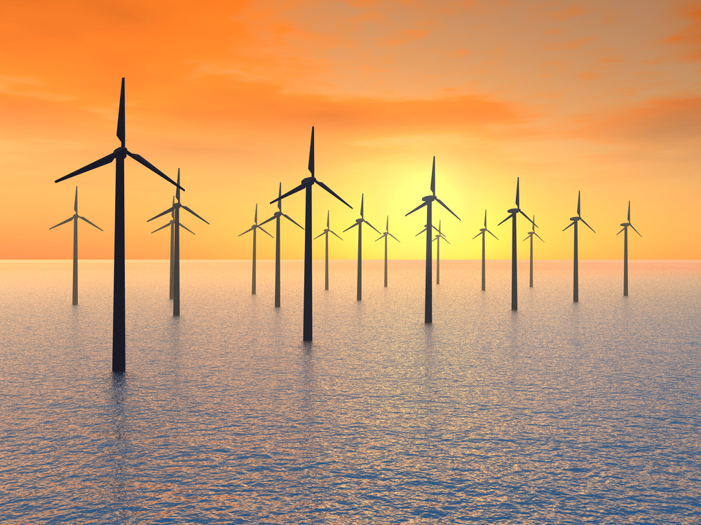 Offshore Wind Mills with a orange and yellow sunset
