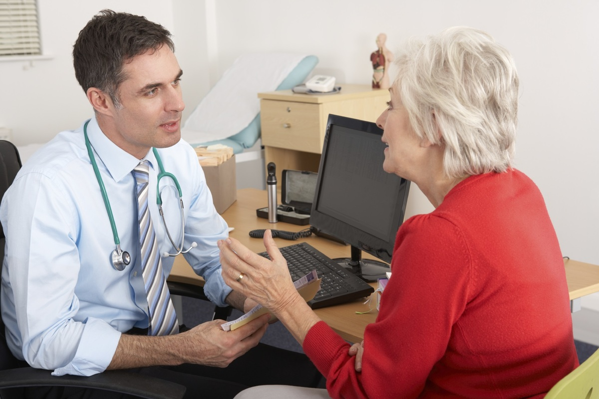 Doctor in consultation with out patient