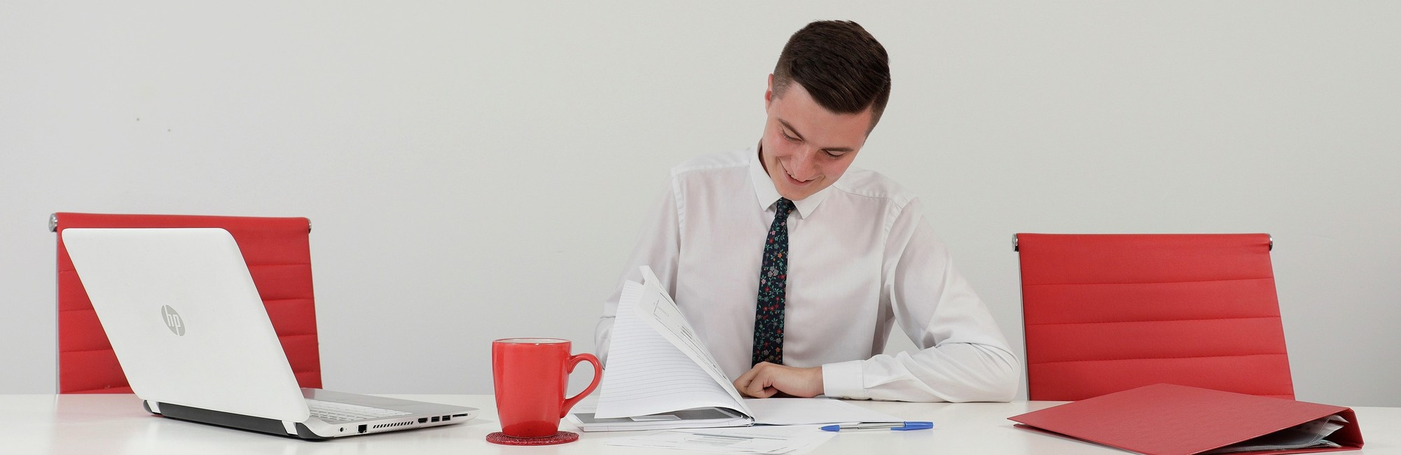 business professional, smiling worker, mug, tea, coffee, chairs, folder, pen, note pad,
