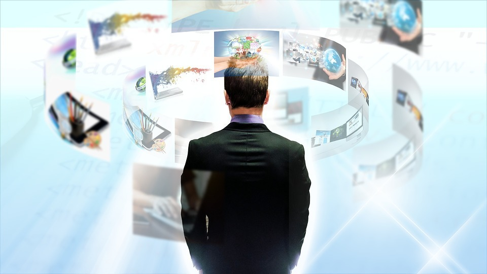 recruiter standing in front of technology images