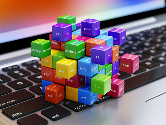 Image contains a laptop and cubes with Development skills
