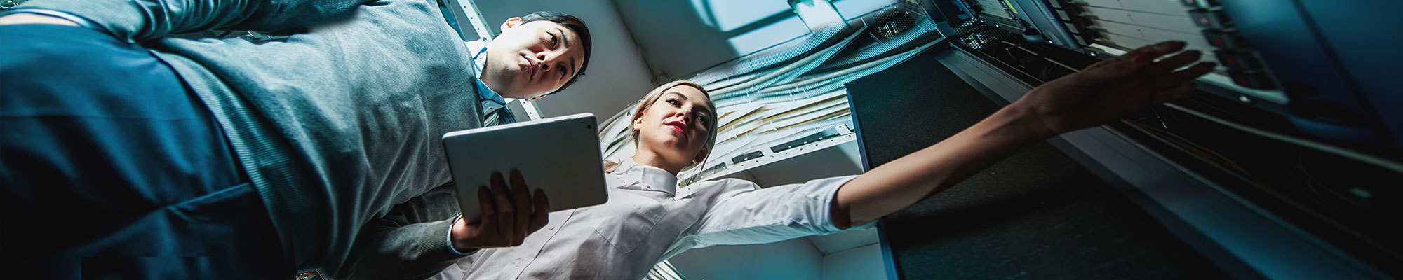 A man and a woman looking at new sources of technology - Entech Technical Recruitment