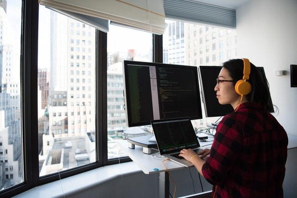 Front-end developer looking out of window
