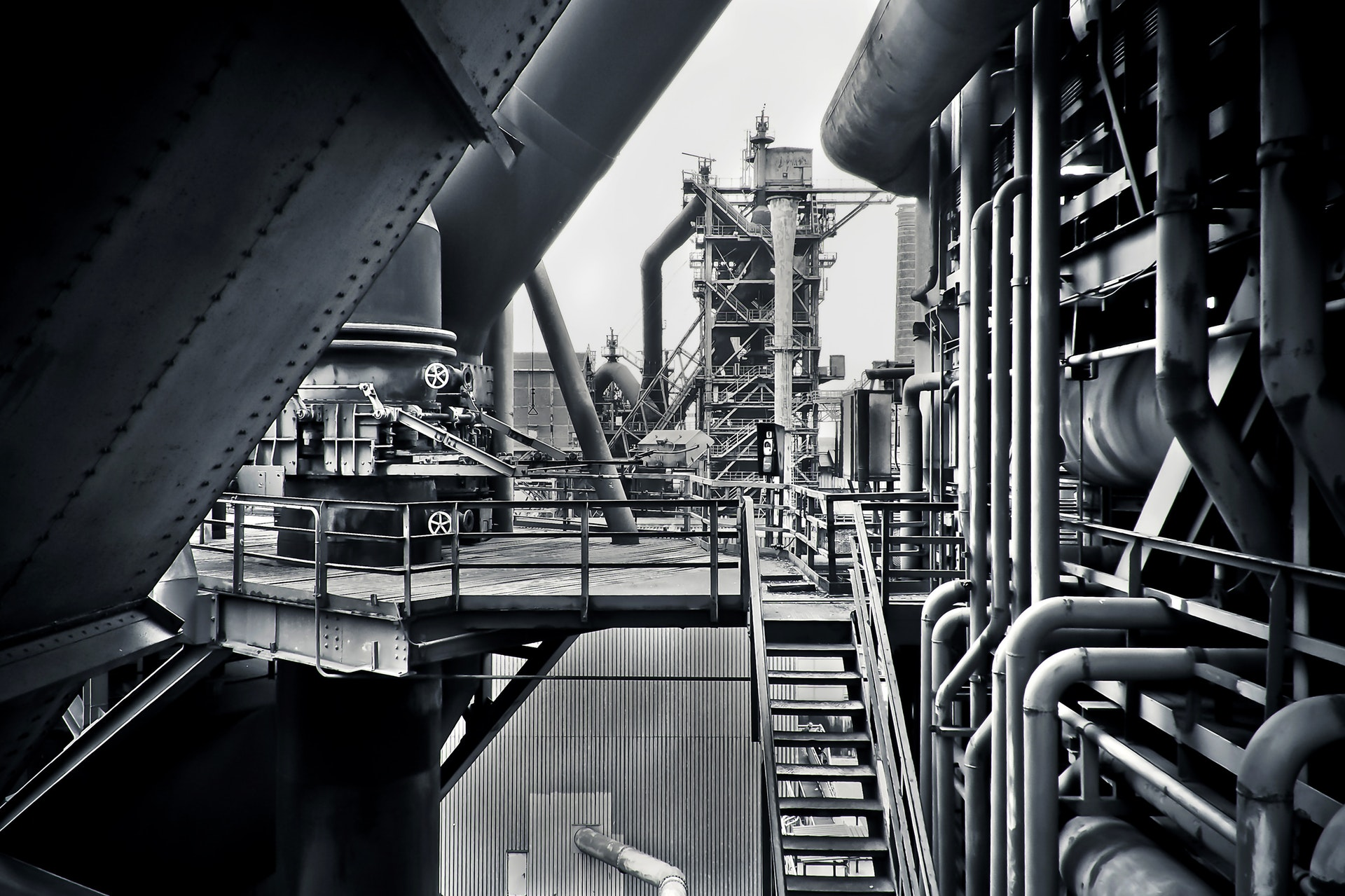 Greyscale Image Of An Industrial Plant - Industrial Engineers - The 14 Best Engineering Jobs For The Future