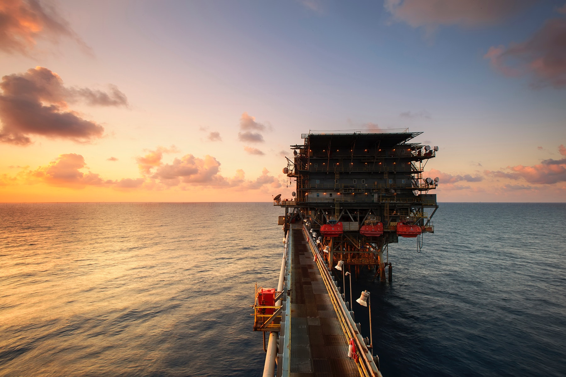 An Oil Rig Surrounded By The Ocean - Petroleum Engineers - The 14 Best Engineering Jobs For The Future