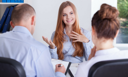 happy red haired woman interviewing with male and female at Swanstaff Recruitment