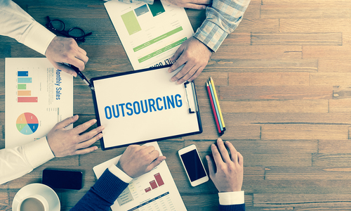 Group of people with documents at a table - Outsourcing solutions at Swanstaff Recruitment