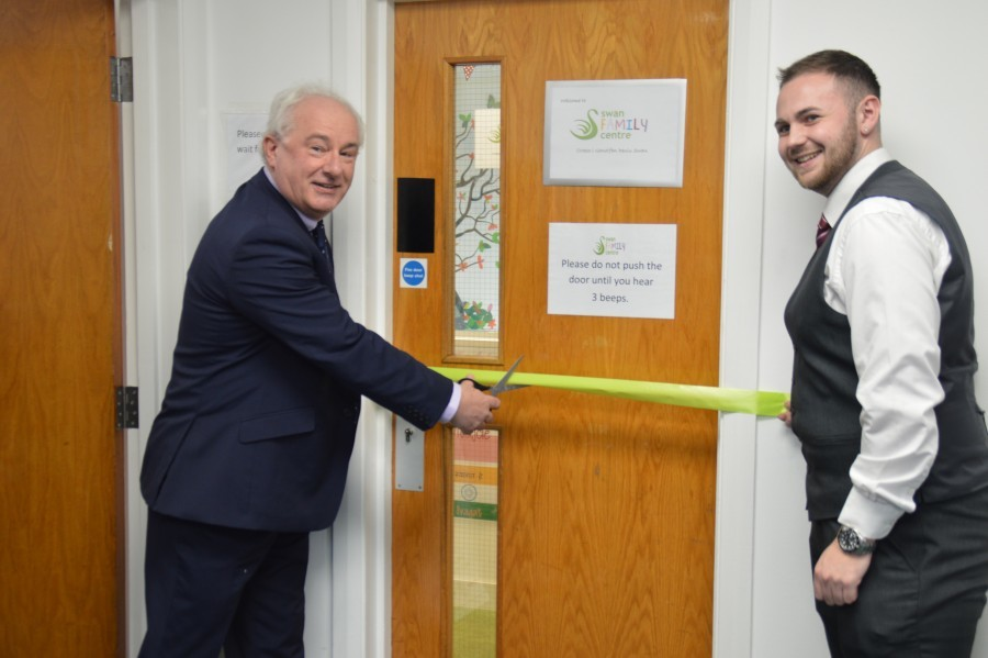 Graham Hinchey cuts the ribbon at Swan Family Cardiff Launch