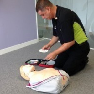 Swanstaff Trainer demonstrating use of first aid defibriliator (AED) during first aid training