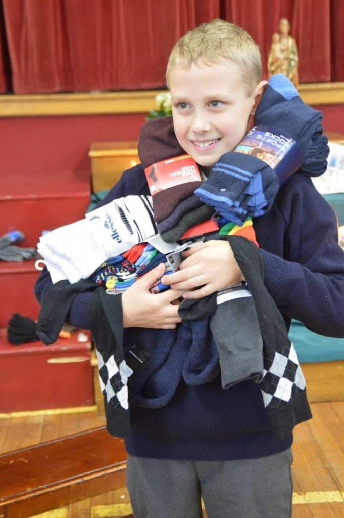 School boy helps Swanstaff Recruitment by collecting 216 pairs of socks for campaign