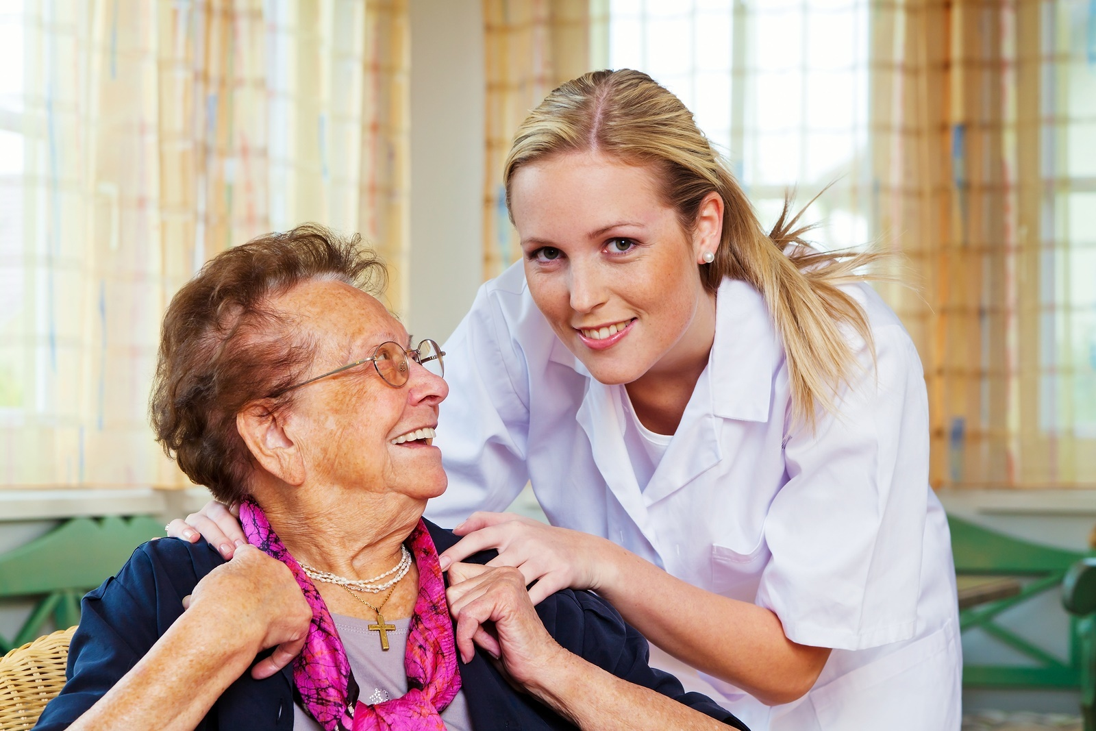 Carer helping elderly lady with dementia