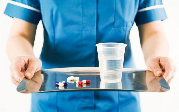 Nurse carrying tray of medicine for patient