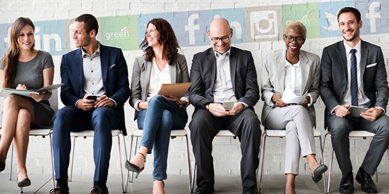 a group of recruiters sitting & using social media