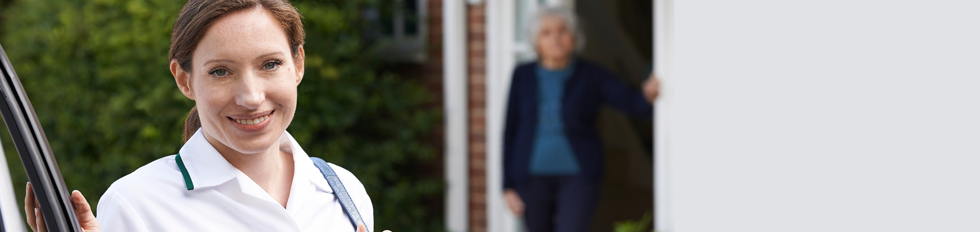 Search Consultancy Care Home Jobs Header Image. Healthcare Header Image Featuring Smiling Care Assistant Outside Care Home.