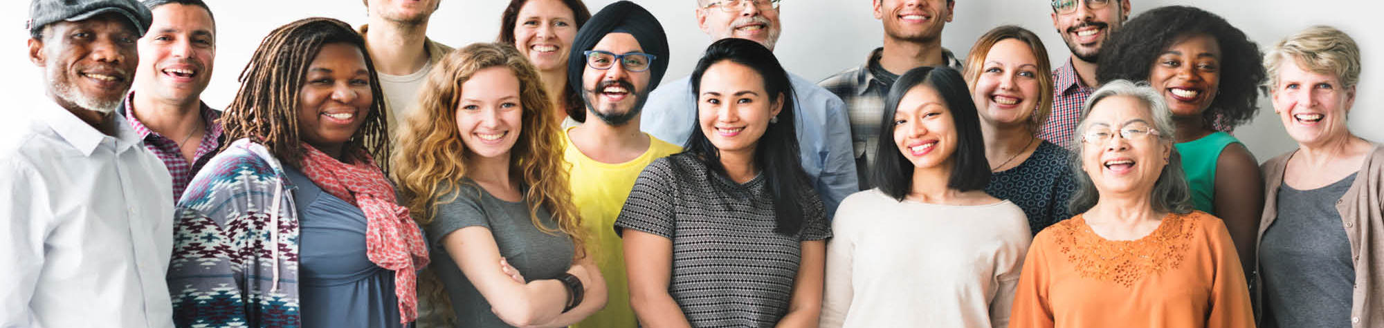 Search Consultancy's 2015 Blog Page Header Image. Diverse group of females and males all smiling representing the exceptional people Search Consultancy employ and recruit.