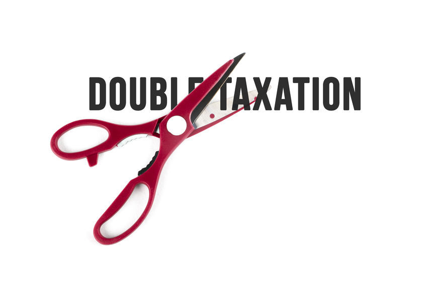 scissors cutting words saying double taxation