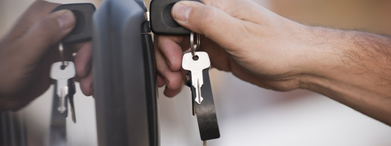 HGV Licence Upgrades Blog Header Image. Featuring hand of male driver putting key in vehicle door. Search Consultancy.