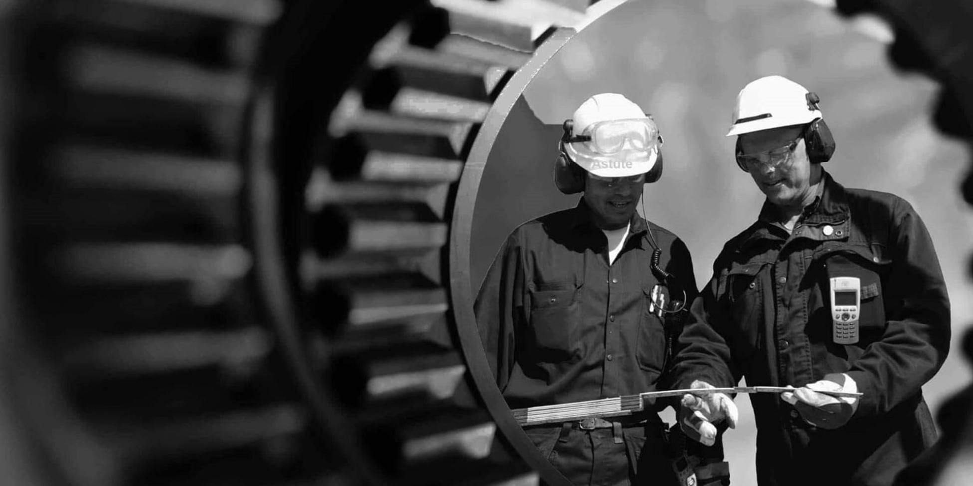 Astute Technical jobs - A black and white photo of two energy workers with hard hats