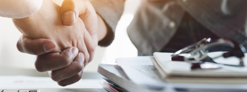 Search Healthcare acquires SCP Aberdeen News Header Image. Featuring female and male business people shaking hands - representing Search Healthcare's acquisition of SCP Recruitment in Aberdeen. Search Healthcare.
