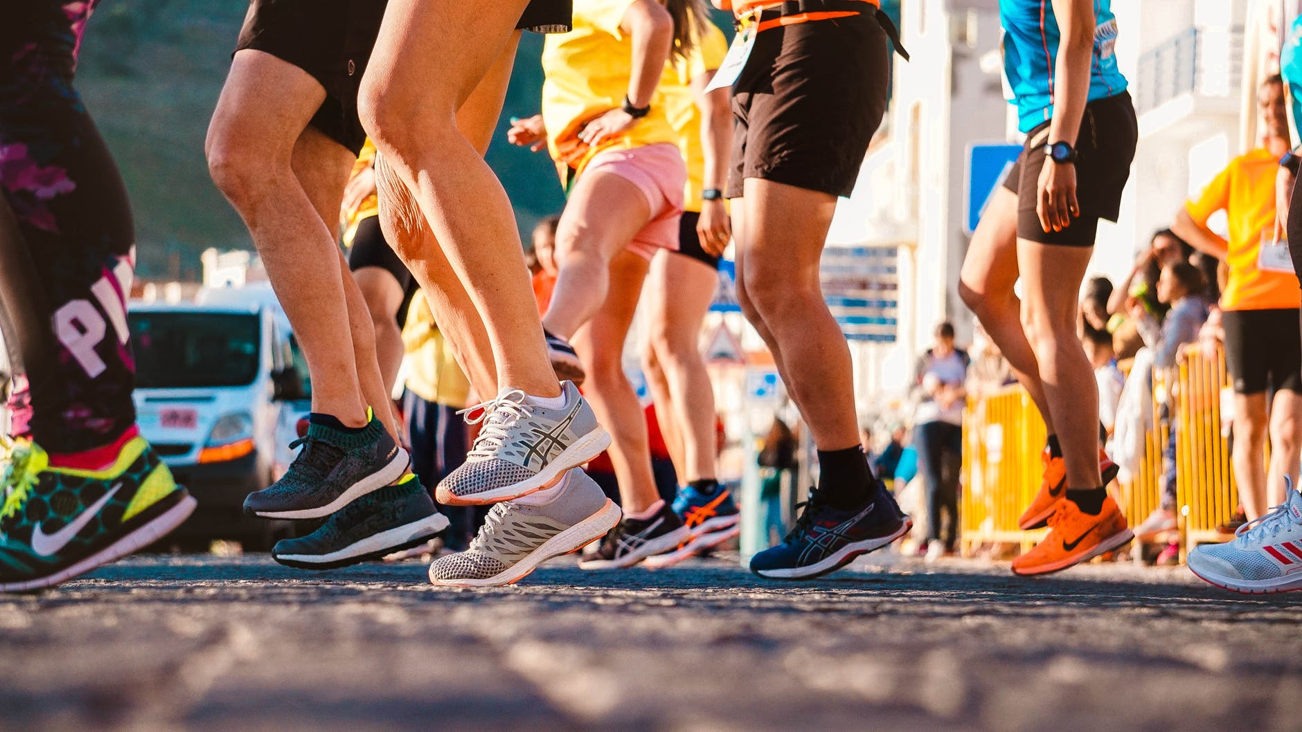 The legs and feet of lots of runners