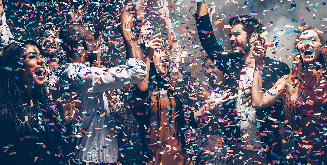 Group of people celebrating with confetti