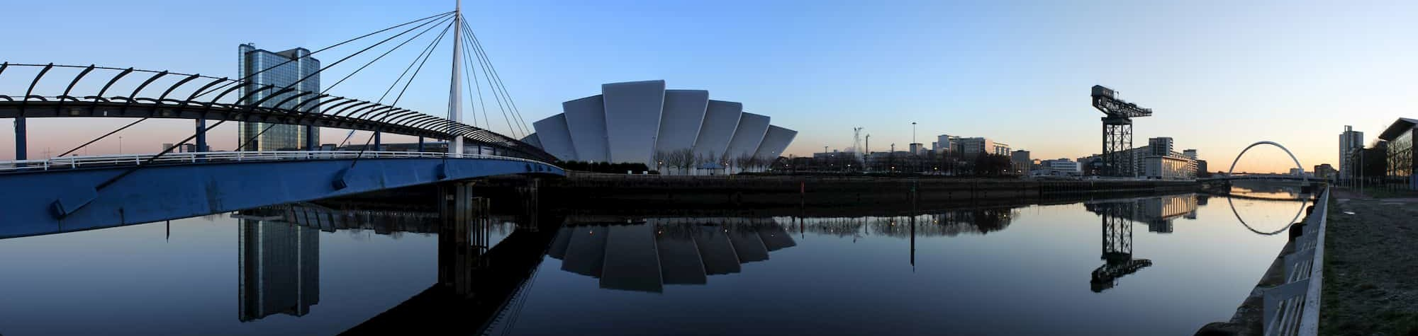 Search Consultancy Glasgow Header Image. Featuring a panoramic view of the Clyde Arc Bridge, Scottish Exhibition Centre and other landmark buildings along the River Clyde in Glasgow. Home to one of Search's exceptional recruitment agencies.