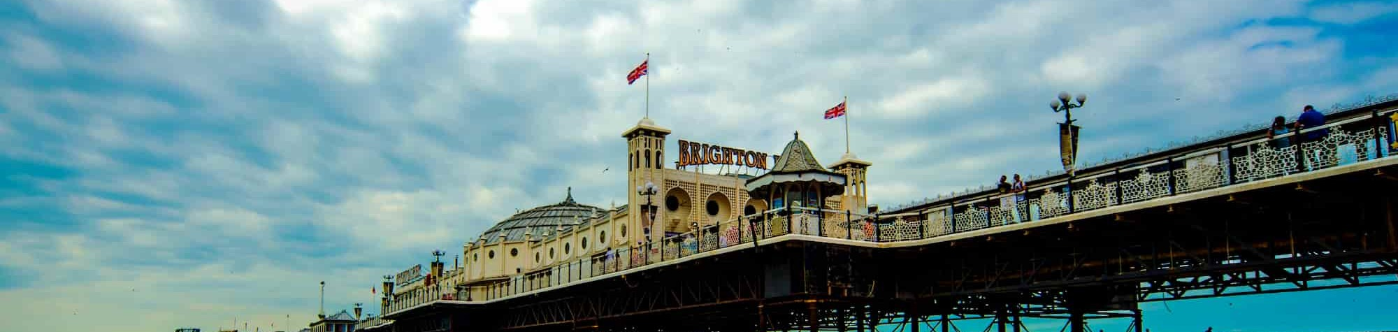 Search Consultancy Brighton Header Image. Featuring panoramic view of iconic Brighton pier and sign overlooking the sea. Home to one of Search Consultancy's exceptional recruitment agencies in England.