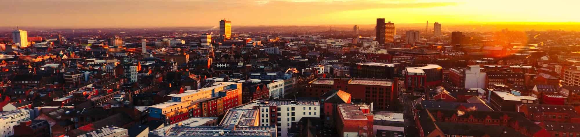 Leicester Recruitment Agency Header Image. Featuring an overhead view of Leicester city centre at sunset, with an array of landmark buildings and streets. Leicester is home to one of Search Consultancy's exceptional recruitment agencies in England.