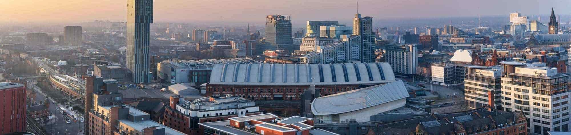 Manchester Recruitment Agency Header Image. Featuring panoramic view of Manchester city centre at sunset, with the Hilton hotel and other landmark buildings. Manchester is home to one of Search Consultancy's exceptional recruitment agencies in England.