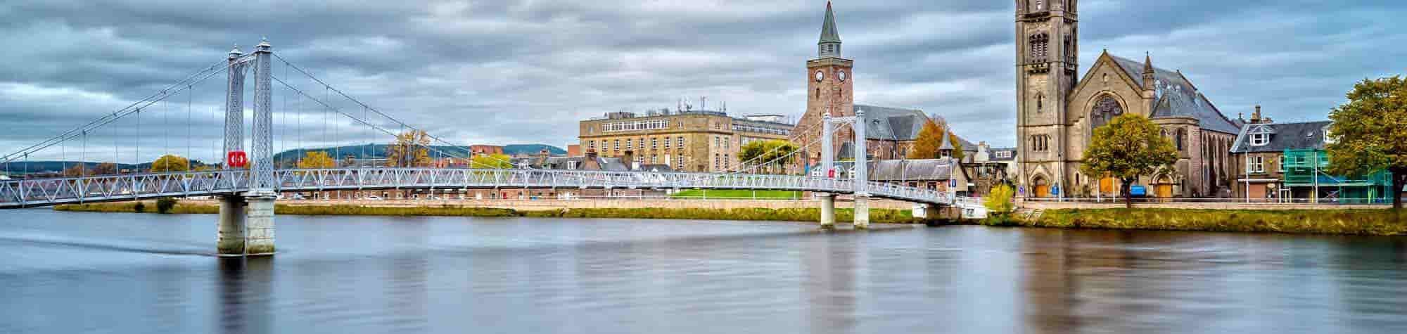 Inverness Recruitment Agency Header Image. Featuring panoramic view of cityscape comprising an array of Inverness landmark buildings along the River Ness. Inverness is home to one of Search Consultancy's exceptional recruitment agencies in Scotland.