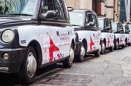 London taxis with think Gibraltar advertising